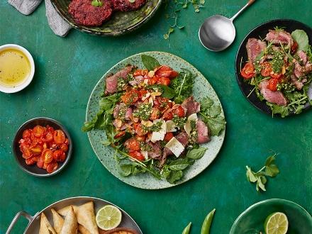 BEEF TAGLIATA SALAD WITH TOMATOES, ROCKET AND BASIL