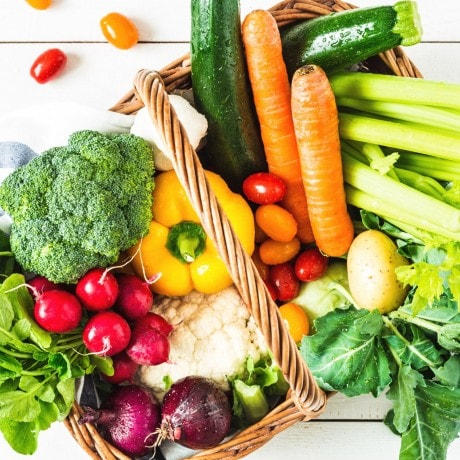 Top view of a basket filled with colourful fresh vegetables